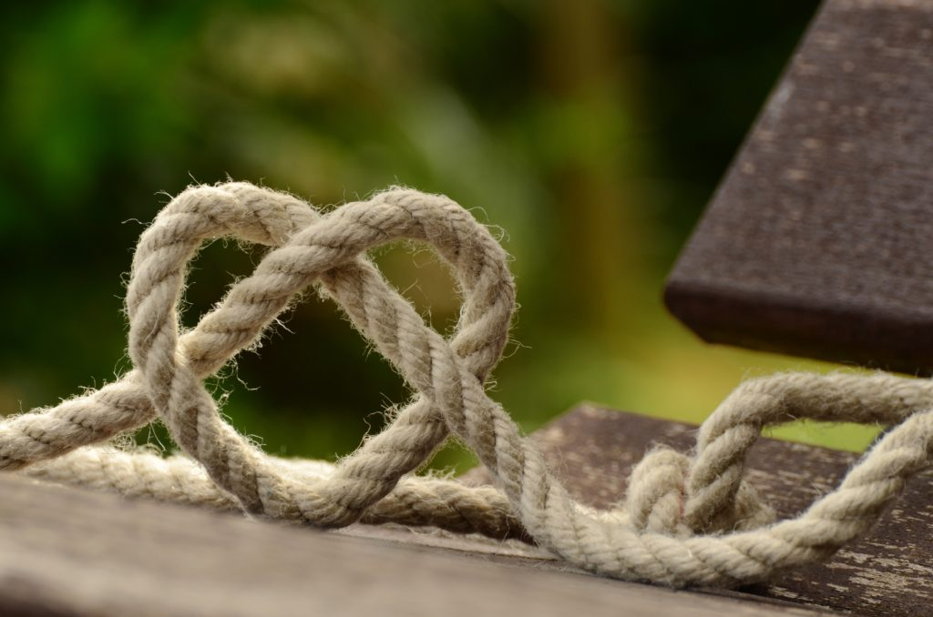 brown-rope-tangled-and-formed-into-heart-shape-on-brown-113737 (1)